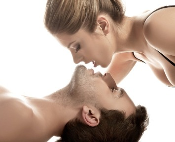 Conceptual portrait of a young couple gentle kissing